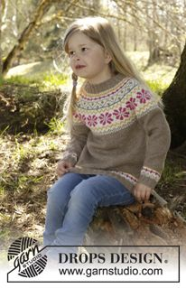 "Prairie Fairy Hat / DROPS Children 27-6 - Knitted DROPS hat with Nordic pattern and pompoms in ""Lima"". Size 3 - 12 years - Free pattern by DROPS Design"