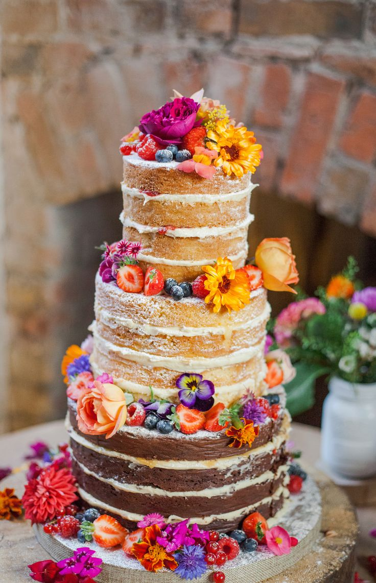 Stunning naked wedding cake with organic edible flowers from http://maddocksfarmorganics.co.uk. Cake made by http://www.theorganicweddingcakecompany.com. Photography by Ria Beth Photography. Wedding o(Summer Bake Ideas)