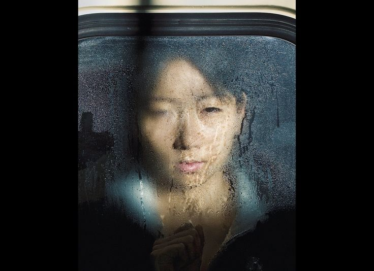 Michael Wolf's 'Tokyo Compression' Features Zen Commuters (PHOTOS)