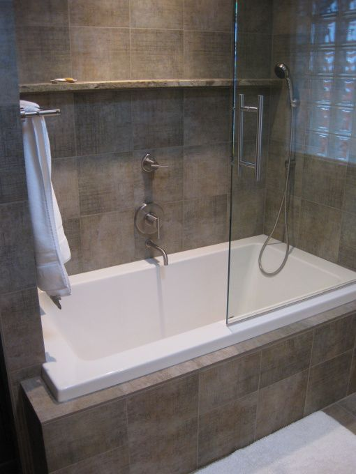 Wonderful Small Tub Shower Combo With Glass Door Completed And White Towel Also Ceramic Wall Tiles Idea And White Bathtub Near Faucets Decorated