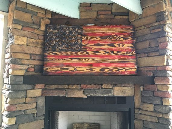 One of a kind rustic wooden America flag. The stars are engraved then torch burned to give a true genuine look. Made from furniture grade Southern