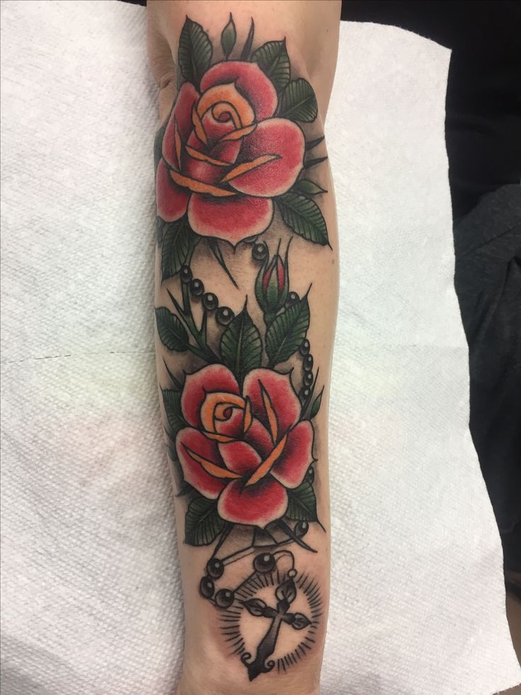 Traditional American rose and rosary tattoo. Artist Javi Campos