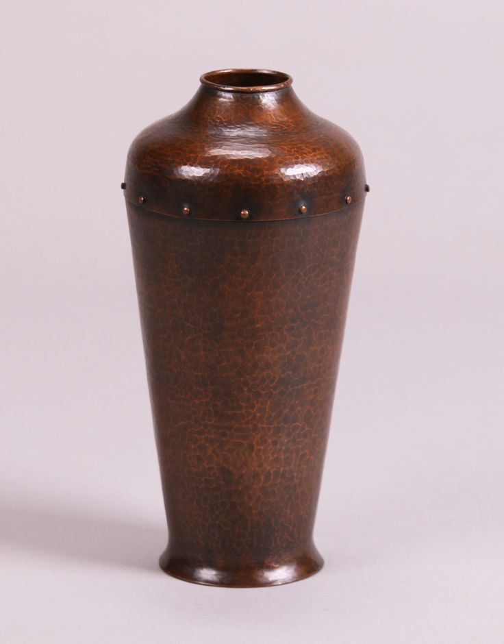 John L. Wilocx (not Wilcox) hammered copper vase with riveted shoulder.  For a similar example see Bay Area Copper 1900-1950, Dirk van Erp & His Influence, page 106, figure 275. 11″h x 5″d    Arts and Crafts