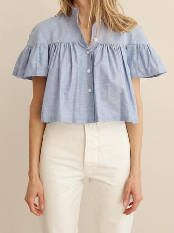Cropped oxford cotton blouse. Band collar, cropped. 100% cotton. Made in USA
