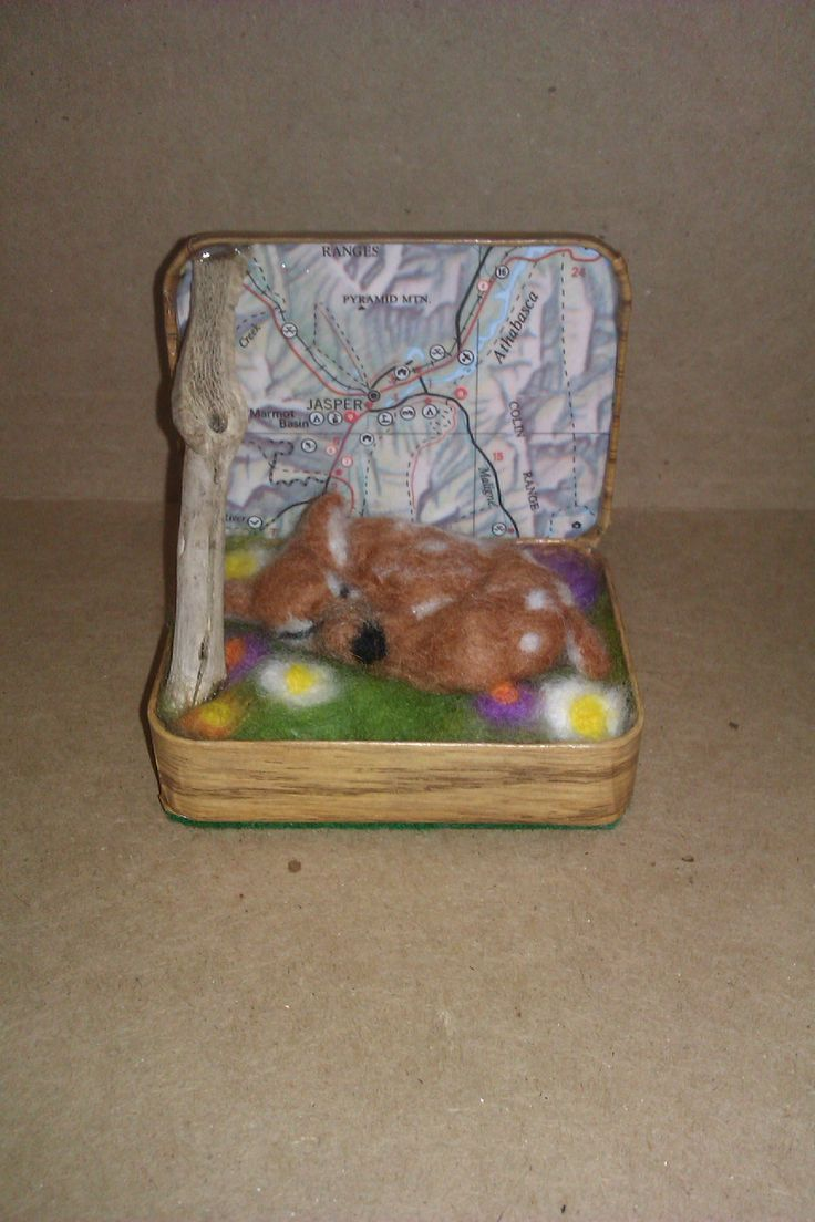 """""""Sleeping Fawn""""; 2014; needle felted sculpture by Holly Boone of Polar Lights Art Studio. Currently located at the Alberta Craft Council. - SOLD! http://polarlightsart.wix.com/plas#!hollys-work/cq0w"""
