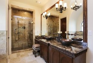 Mediterranean Master Bathroom with Dulles Glass and Mirror, Frameless Shower Screens., Honed travertine floor and wall tile