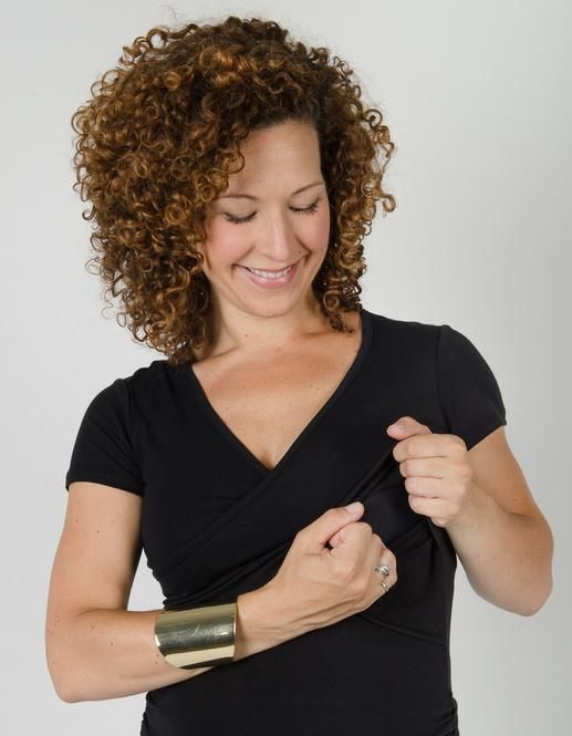 This practical and cute top is designed to be worn through all stages of pregnancy and nursing. The ruched sides let the shirt grow with your belly.  #breastfeeding #momzelle #nursingtop