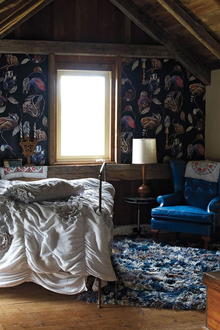 anthropologie home decor dark blue wallpaper blue chair bedroom