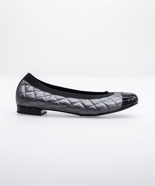 The ballet flat that never goes out of style, this classic quilted slip-on will be the chic shoe you reach for again and again. Make your basics anything but basic. Available in black nappa with black patent toe cap or pewter nappa with black patent toe cap.   Ultrasuede footbed for a slipper-like feel with a flexible rubber sole. Made in Spain.