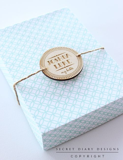A5 size box printed with a modern trellis pattern and finished with a wooden engraved round seal thread through twine. By http://www.secretdiary.co.za #packaging #Box #BibleBox #Christening #Dedication #Blue #GiftBox