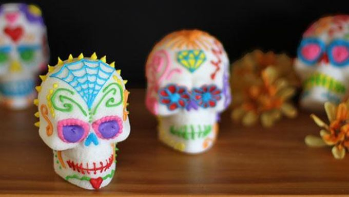 Traditional Day of the Dead Sugar Skulls are decorated with a rainbow of colored royal icing.
