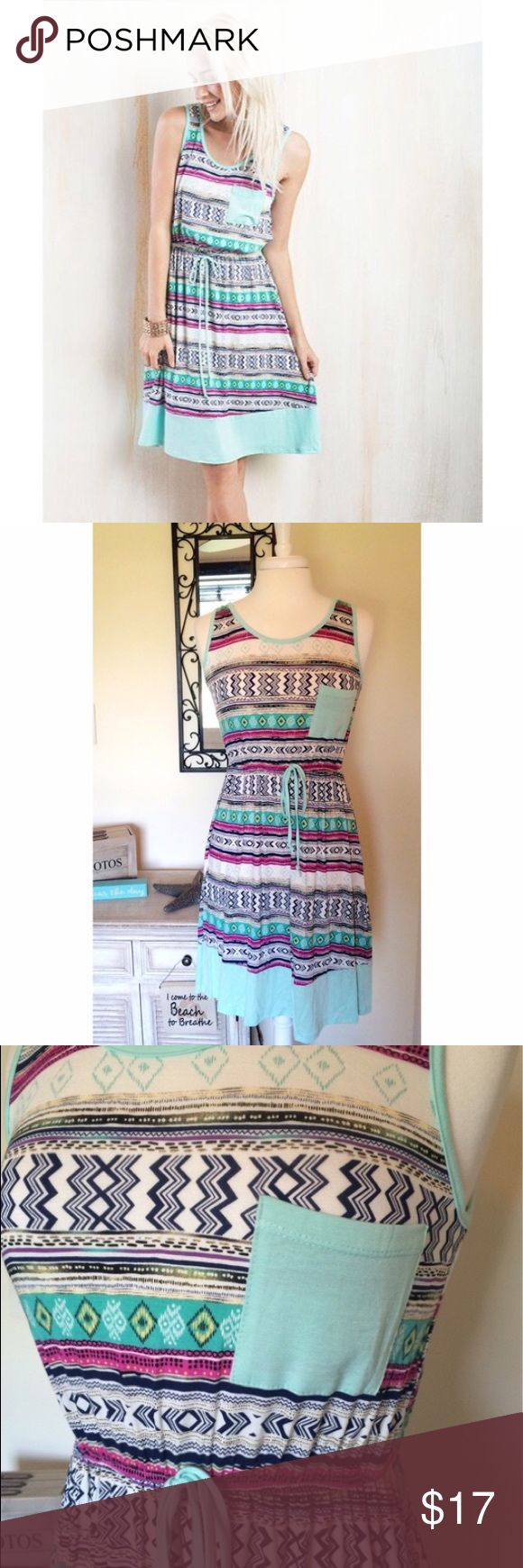 Aztec tribal print knit dress nwot mint This dress is soooo pretty, but unfortunately I just never have the occasion to wear it. It is a flowy knit fabric and flattering silhouette with drawstring detail at waist. Size Large. I removed the tags when I tried it on, but it has never been worn. Please help me find this beauty a good home!! 🚫trades. Save 15% when you bundle!! Note: pics are not mine—this is a reposh. Dresses Midi