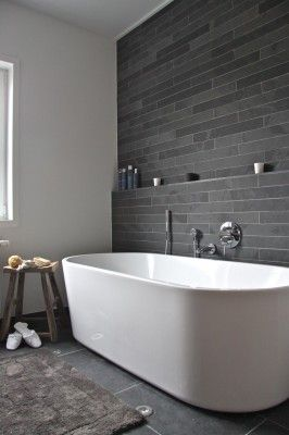 One wall tiled, one painted - also white bathtub