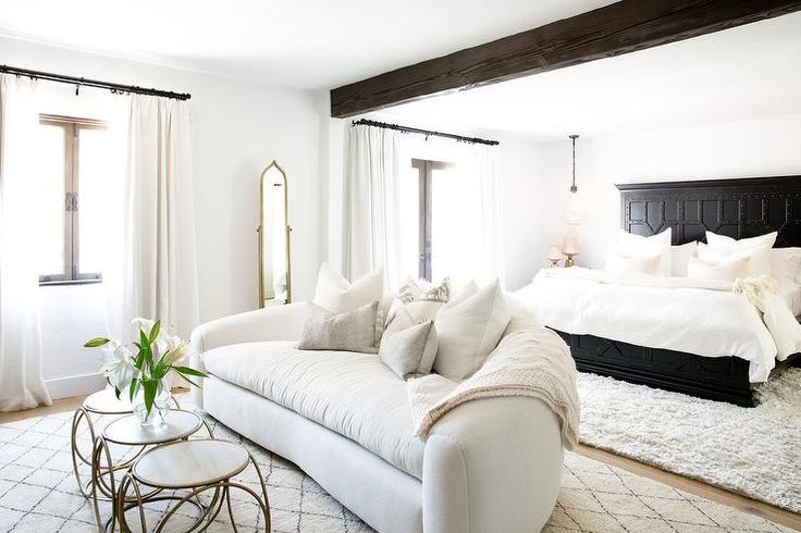 Black and white Spanish style bedroom showcases a Restoration Hardware 17th C.