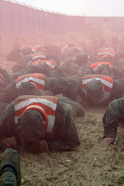 US Navy SEAL Candidates Crawl Through Smoke And Explosions By AN HONORABLE GERMAN Via Flickr