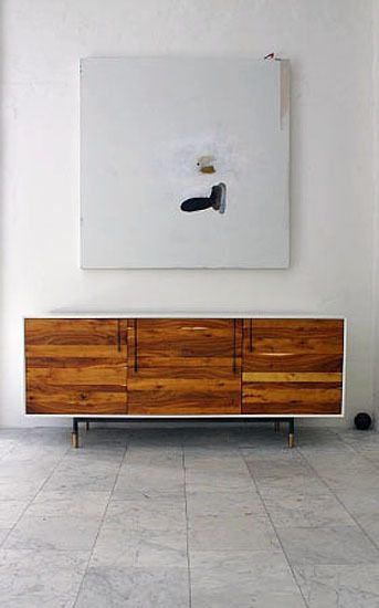 Wood combined with lacquered white is a lovely combination of earthy and polished-modern that can lend a clean, graphic punch to a room. In the most wonderful examples, the white highlights a piece of distinctive wood, as is the case with the Lake Credenza by BDDW. In all cases, it's all about contrast: the warmth of the wood set against the coolness of bright white. This combination can often read as classic mid-century modern, but it works well with many styles.
