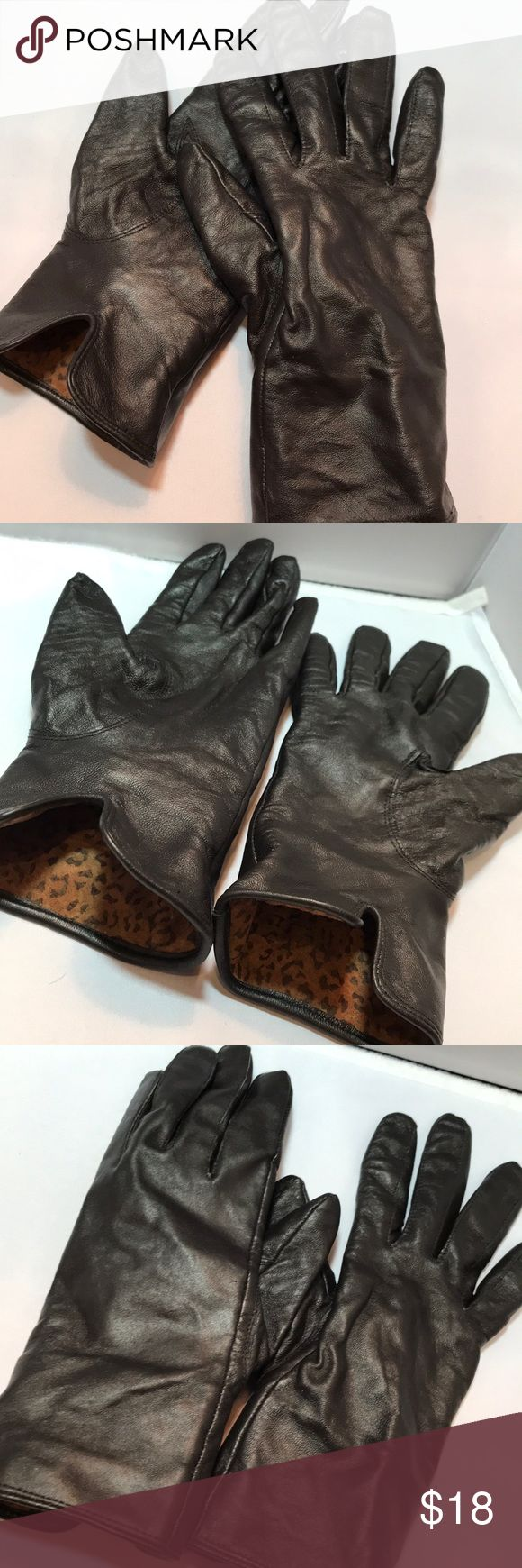 Black leather gloves lined in soft warm fabric Lower 1/3 interior of glove lined with animal print leather   No brand tag found but these appear to be well-made gloves   Leather not buttery soft ... more of a firm durable medium soft feel   I wear large ladies gloves and these are too tight on me ... medium size  Very good condition   Will keep your hands nice and warm Accessories Gloves & Mittens