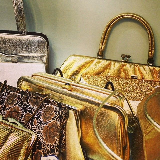 We have a wide selection of gold bags, from vintage to modern! Check out the Downtown Accessory Boutique or shop online!
