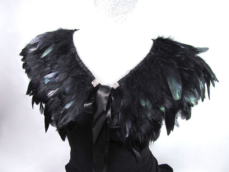 Need a little something over your shoulders or want to accessorize your dress or gown? This feather caplet will add drama and style to any garment or occasion. The piece is made up of black coque rooster feathers in a collar style garment. The feathers have an iridescent sheen to them which adds to the style. I have hand embellished the piece with square rhinestone pieces for a accent of sparkle. The collar measures 26 long and is 7 wide. It is trimmed in black satin and has satin ties. It…