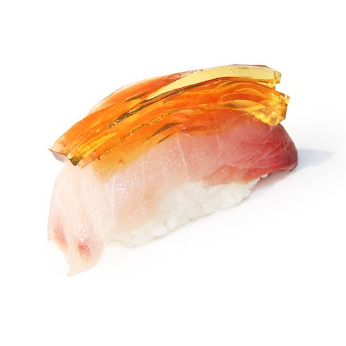 """The chefs at Hong Kong's Shiro restaurant have used innovative techniques to create """"crystal""""  sushi. Flavors like sake, aji sauce and even rose petals have been infused into jelly, which are paired and balanced over the various options in Shiro's nigiri collection. Pictured here: blue fin tuna, Japanese dashi jelly."""