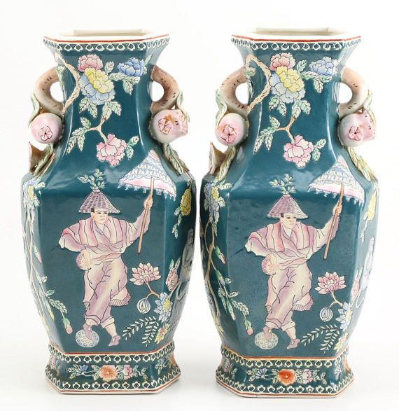 "This is a fantastic pair of ceramic Chinese vases. Each is hexagonal shaped vases. Hand painted with a teal blue background color, they feature pastel human figures and monkeys among floral patterns. The vases are trophy shaped with finely detailed pomegranate handles. Makers mark sticker reads ""Made in Macau"".  Excellent vintage condition - no chips or cracks.  Each vase is very heavy - this will affect shipping price.   Approx Dimensions of each: 7.0 W x 14.0 H x 5.0 D"