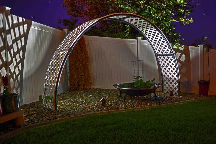 Farmer Pete repurposed a 12' trampoline frame into a grape vine garden arch.