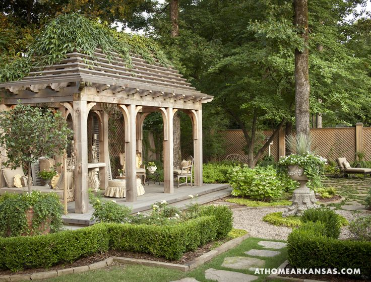 A wooden arbor is the grand focal point of the backyard escape. Evergreen clematis covers the rooftop providing shade and adding character.