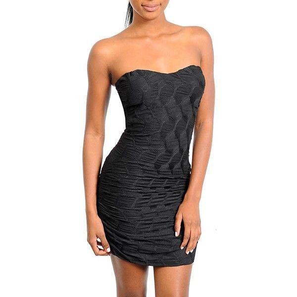 Kort zwart jurkje voorzien van bewerkte stof en soft cups in de buste. Gemaakt van 96% polyester en 4% spandex.    http://www.lookinggoodtoday.com/dames-kleding/jurken