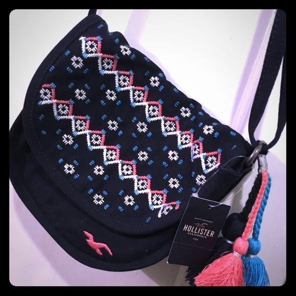 Hollister Handbag Hollister small handbag without no zipper. It's navy blue brand new with original tag. Hollister Bags Shoulder Bags
