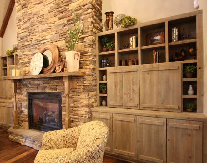 Family Room With Stone Fireplace And Rustic Built In