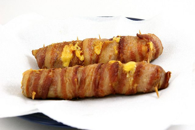 Deep fried bacon wrapped hot dogs