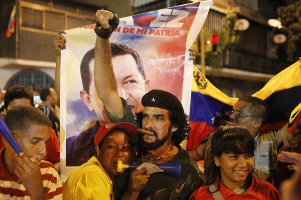 Hugo Chavez beat opposition candidate Henrique Capriles, giving him another six years to implement his Bolivarian revolution. #hugo #chavez #venezuela #news