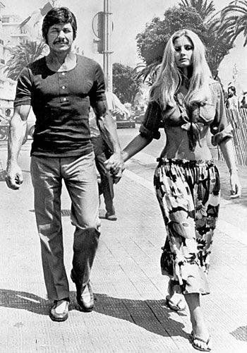 Actress Jill Ireland was born 4-24-36 -- she was married to Scottish actor David McCallum. On Oct 5, 1968, she married fellow actor Charles Bronson. They remained married until her passing in 1990 from breast cancer.  They are shown here walking in Santa Monica, Cali in the early 70s