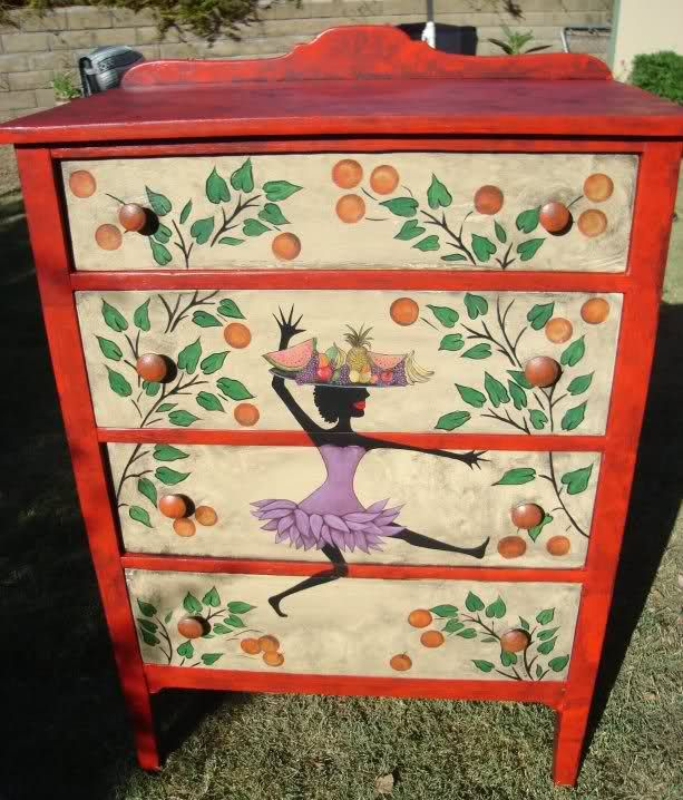 Another el cheapo dresser I picked up at a yard sale for 10 bucks. It was in pretty sorry shape, so I painted it red, then used left over house paint (the cream) on the front. Knobs were missing so I bought wooden ones that were round..to match the oranges in the tree. Stencil was bought from Victoria Larsen on ebay. The oranges were made with a round sponge. The lady with the fruit on her head was hand sketched with pencil, then painted in by hand. ~Bren H