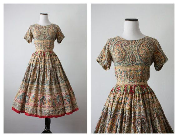 Vintage 1950s cotton dress in two pieces. Indian inspired print with paisley and images of dancers, horses, and oxen.
