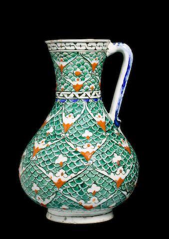 An Iznik scale design pottery Jug Turkey, second half of 16th Century  Sold at Bonhams for £100,150