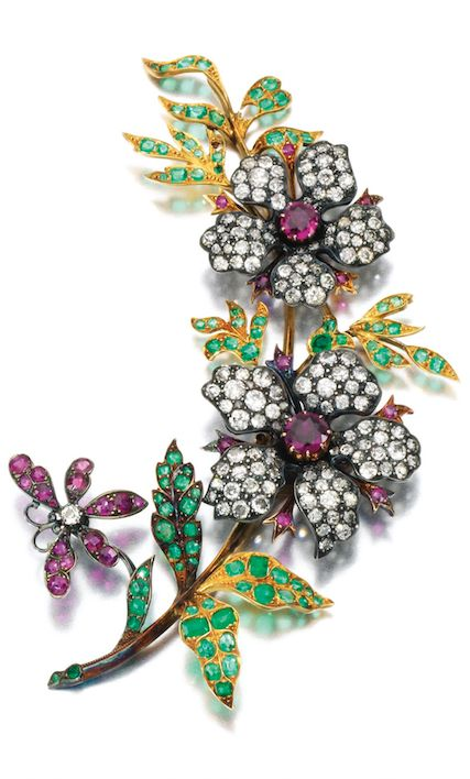 *GEM SET AND DIAMOND BROOCH, LATE 19TH CENTURY Designed as a floral spray, set with circular-cut and rose diamonds accented with mixed-cut emeralds and rubies, detachable brooch pin to reverse, two small emeralds deficient.