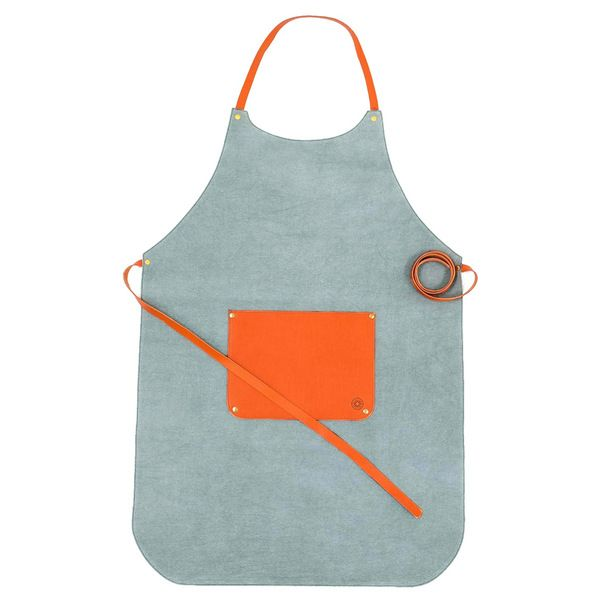 A hard-wearing green canvas apron that is water-resistant and features a spacious vegetable-tanned leather front pocket.    Designed by La Portegna, handcrafted in Spain and available online from waremakers.com