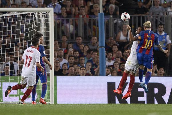 Barcelona's Argentinian forward Lionel Messi (R) scores during the second leg of…
