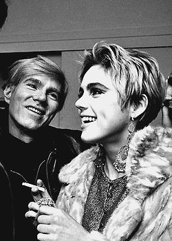 Edie Sedgwick and Andy Warhol at a party, 1965.