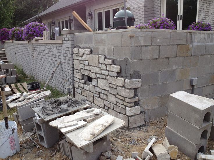 Cinder block retaining wall stone facade design for Block wall landscape design