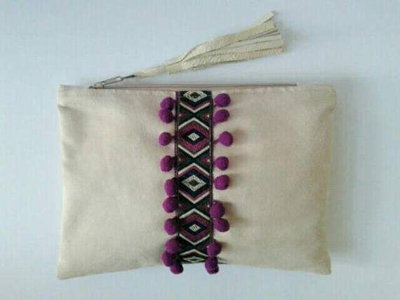 Check out this item in my Etsy shop https://www.etsy.com/listing/518826529/boho-chic-ivory-clutch-with-pom-poms-and