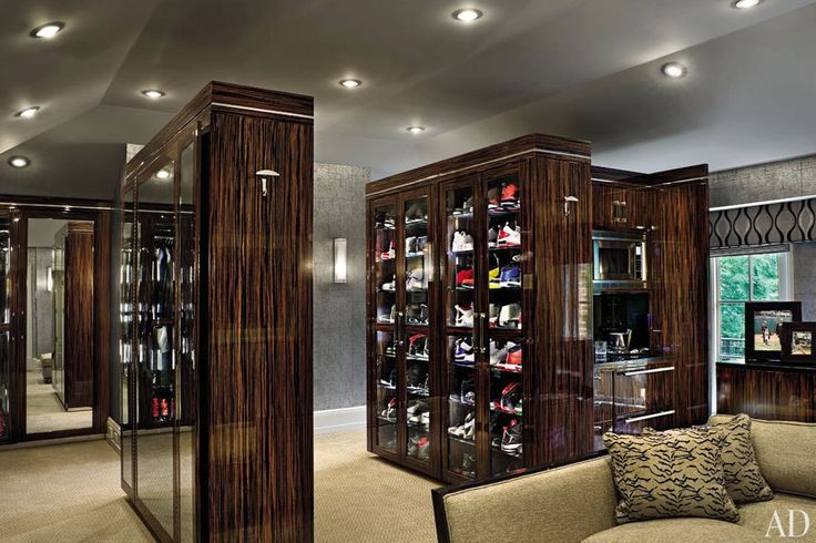 Yankees star pitcher C. C. Sabathia's  spacious closet/dressing room,  outfitted with rows of Macassar-ebony cabinets to house his extensive collection of shoes. There's also a bar, just in case making a choice is too taxing a burden...
