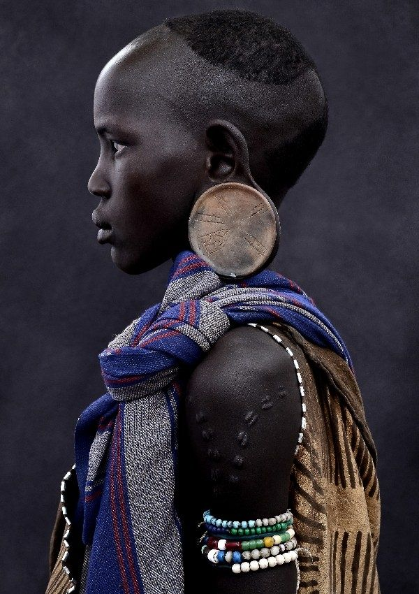 african faces - Tribal dress, profile