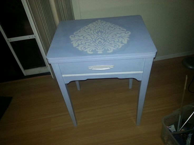 Vintage sewing machine table I painted and now I think makes a cute end table or bed side table