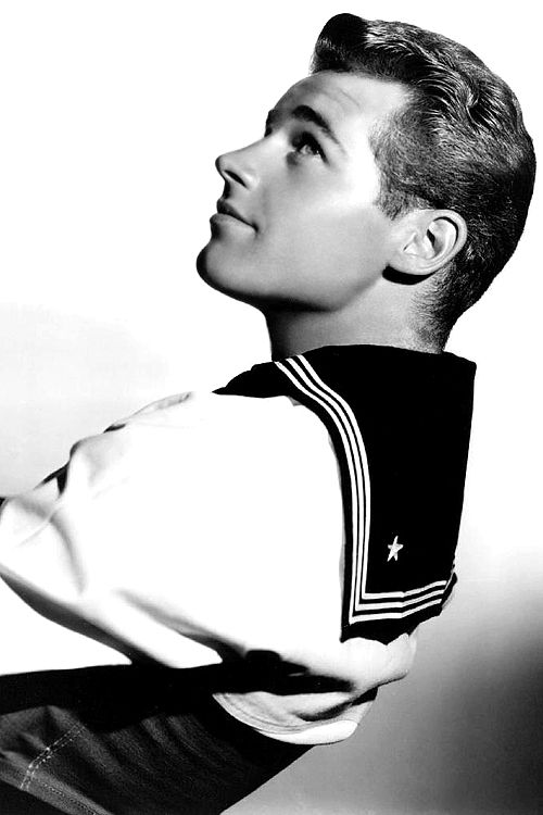 U.S Film Star Guy Madison was working as a telephone linesman but on the outbreak of WW2 joined the U.S Coast Guard. While on a liberty visit to Hollywood's Lux Radio Theatre he was spotted by a producer who needed a sailor for a prominent film role and so his acting career began. His real name was Robert Moseley.