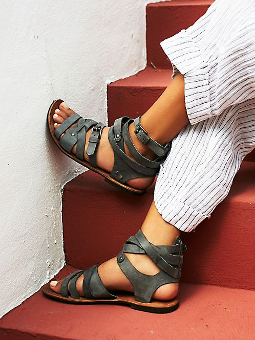 $98 Romana Fest Gladiator Sandals | Open toe sandal with criss-crossing straps all the way up. Zipper closure up the back. Eight adjustable buckle closure straps on side. Exclusively designed for Free People.   *Jeffrey Campbell for Free People