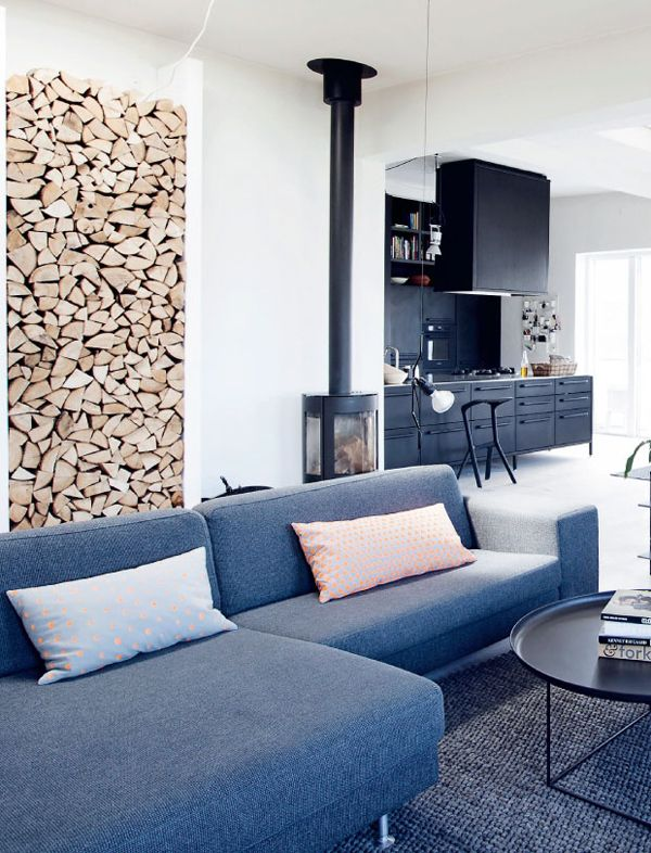 Beautiful wood feature and burner in this living room. From The Copenhagen home of Vipp's Head Designer