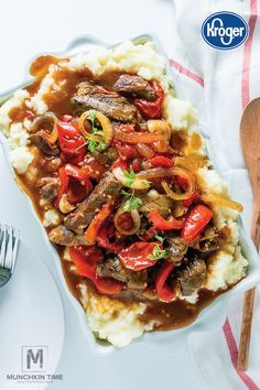 Busy weeknights mean less time to cook a nutritious meal for your family. Luckily, this Pepper Steak makes it easy with a handy slow cooker hack. Simply allow beef sirloin, garlic, onions, bell peppers, tomatoes, soy sauce, and steak seasoning to come together in a slow cooker. Then, serve with mashed potatoes for the ultimate winter comfort food.