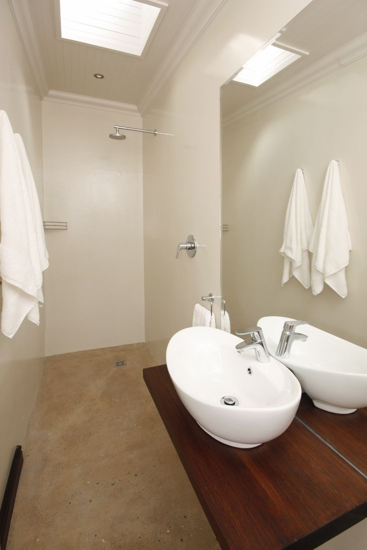 Bathroom in our standard rooms. Quite narrow - not the biggest - but all have a nice walk in shower.